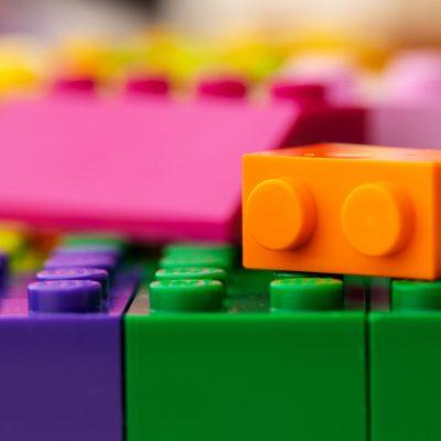 Details of children's plastic building kit close up photo